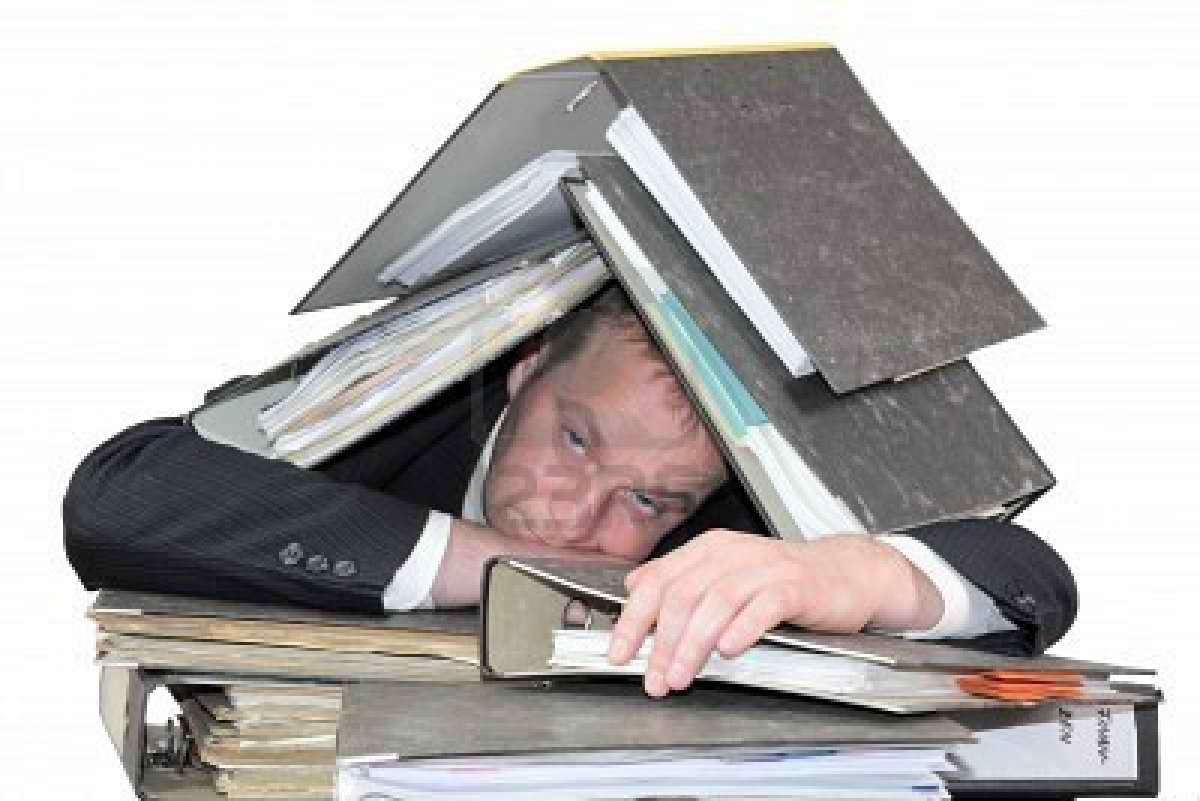 8807242-burn-out--the-man-is-buried-under-stacks-of-files