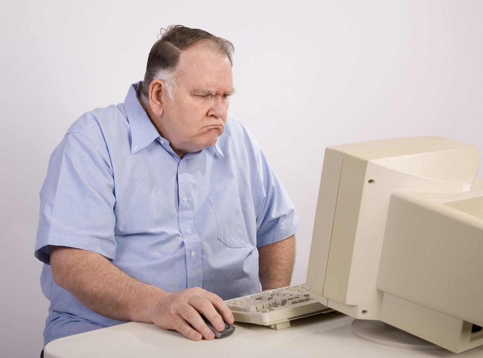 Grumpy guy at computer